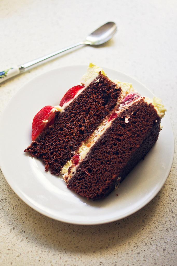 A slice of strawberries chocolate cream cake